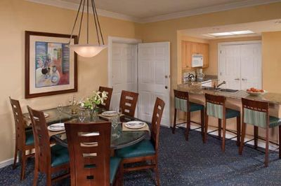 Dining and kitchen area in a villa at BeachPlace Towers Florida
